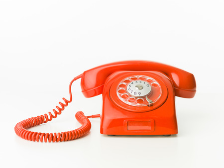 vintage red phone isolated on white background. copy space available