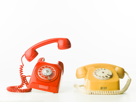 answering call: front view of two vintage phones ringing, isolated on white background Stock Photo