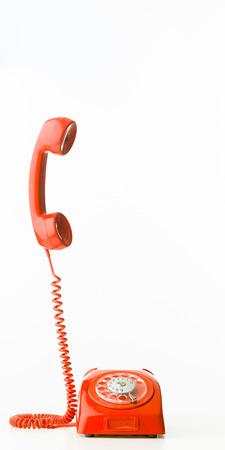 phone cord: retro styled telephone with receiver standing up, isolated on white background