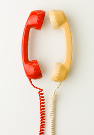 hangup: two handsets facing each other and talking Stock Photo