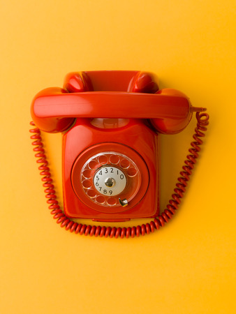 upper view of red vintage phone on blue background