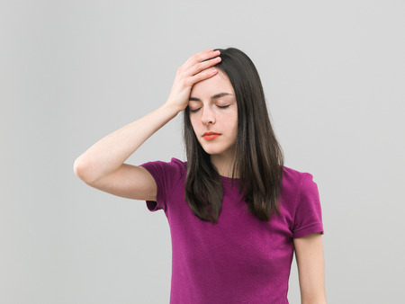 preoccupation: portrait of young caucasian woman suffering from headache Stock Photo