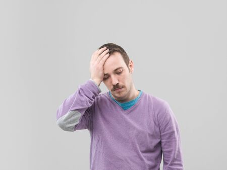 eyesclosed: front view of man having a headache. copy space available