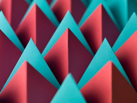 abstract geometrical background with colorful paper pyramids. selective focus Stock Photo