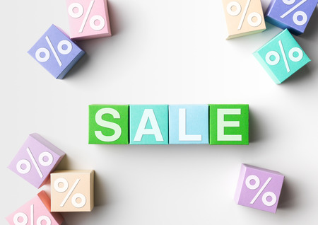 proportional: multicolored blocks with sale word written on them and percentage symbol, on white background. copy space available