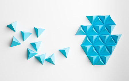 merging: blue paper pyramids merging towards a shape, on white background