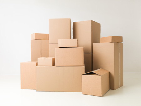 boxes: stack of cardboard boxes on white background Stock Photo