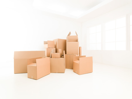 homeownership: pile of moving boxes in empty house. copy space available Stock Photo