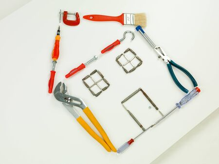homeownership: outline of house made with household and construction tools, on white background. perspective view
