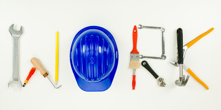 household objects equipment: work word written with construction tools on white background Stock Photo