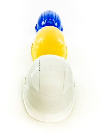 protective helmets: three multi colored protective helmets in a row, on white background