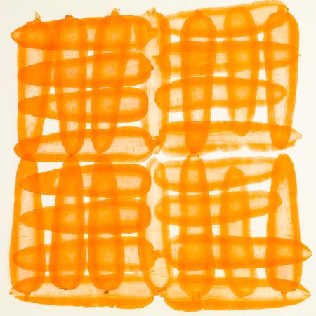 longitudinal: illuminated backlit thin carrot slices arranged longitudinal and transverse Stock Photo