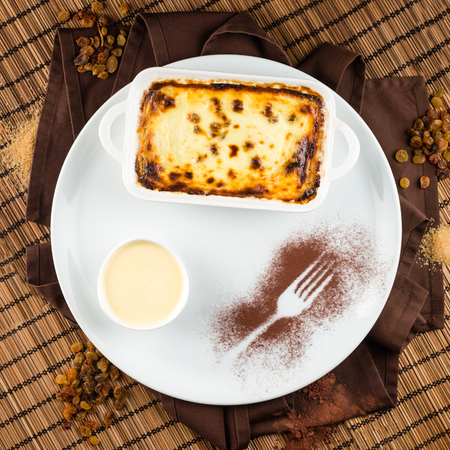 appetising: cream cheese with raisins and vanilla sauce baked presentation restaourant Stock Photo