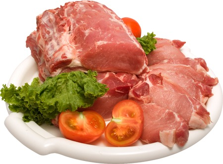 deceiving: white plate containing raw meat with white streaks of fat, lettuce leaves and cherry tomatoes on the side