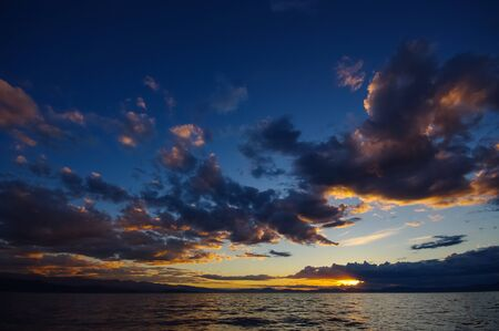 still water: beautiful seascape with spectacular clouds and blue sky, still water and sunrise