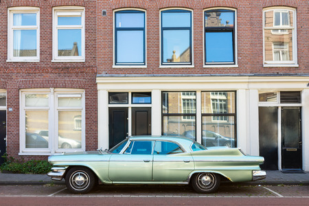 11 year old: Amsterdam The Netherlands - June 11: Old classic car Dodge Matador year of fabrication 1960 parked on the road side in Amsterdam, side view  on June 11, 2015.