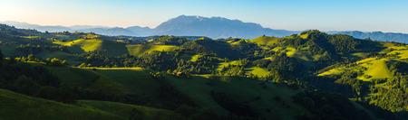 panoramic: splendid panoramic of Transylvanian hills, dominating raw green colours and a beautiful sunrise