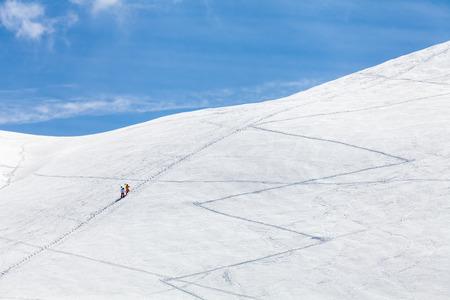 ski traces: traces of ski touring on a ski piste in winter with frozen snow