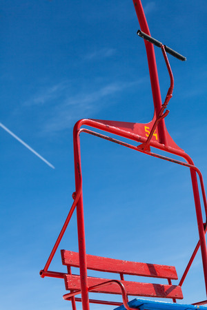 chair on the lift: no people and a single chair lift in motion