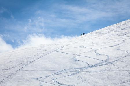 ski traces: traces of ski touring on a ski piste in winter with partial frozen snow