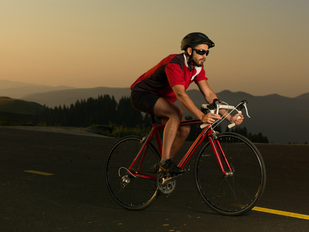 road bike: cyclist on road bike in motion on a sunny day Stock Photo