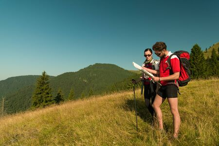 explanations: two people hiking on the mountain in a peaceful afternoon
