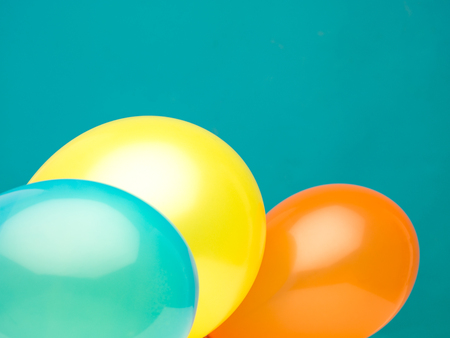 yellow landscape: clean landscape composition made from three balloons aquamarine, yellow, and orange against a cyan background Stock Photo