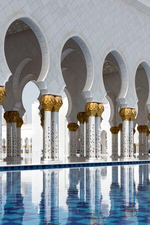 Abu Dhabi, United Arab Emirates - April 12, 2015: Pillars and pool, Sheikh Zayed Grand Mosque in Abu Dhabi, UAE.
