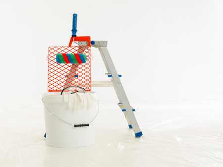 Construction brush, roller, aluminium ladder. The renovation of the house, home repairs. Construction tools, products. Stock Photo