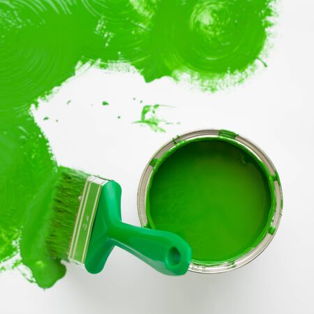 square image: Square image green paint brush with green splash and can. top view with copy space Stock Photo