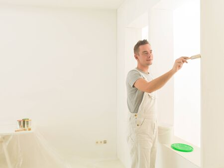 homeoffice: handsome men painting his luminous home-office