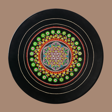 sacral: Abstract sacred geometry hand painted dots technic on an old vinyl record.