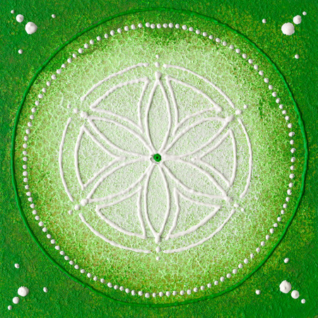 Hand painted seed of life with green and withe colours.