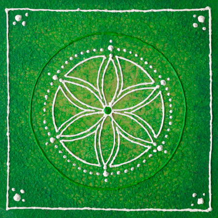 energy healing: Hand painted seed of life with green and withe colours.