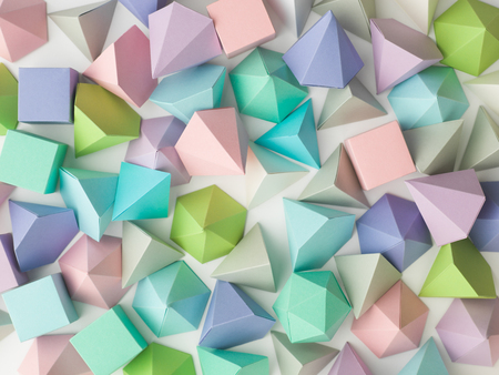 solid figure: Colorful abstract geometric background with three-dimensional solid figures. Pyramid Dodecahedron prism rectangular cube arranged on white paper.