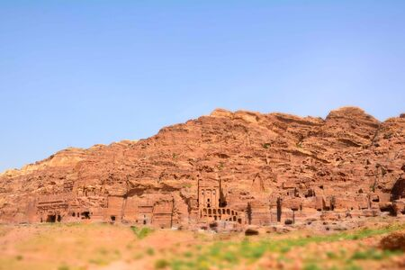 PETRA, JORDAN - APRIL 25, 2016: Cave dwellings in the Rose City of Petra, Jordan. The city of Petra was lost for over 1000 years. Now one of the Seven Wonders of the Word