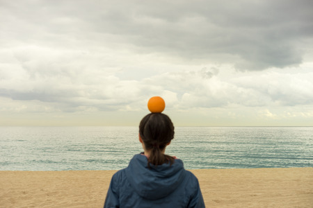 woman with orange on her head 写真素材