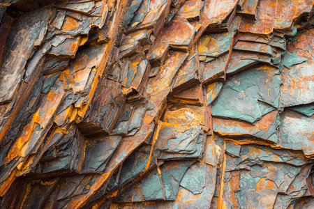 Rock layers , a colorful formation of rocks stacked over time. Interesting background a fascinating texture 版權商用圖片