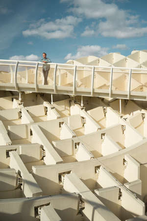 Seville, Spain apr 2 2018 Young man in Metropol Parasol looking at the cityscape