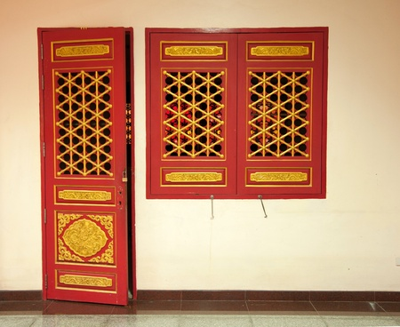 A Red Door and Two Red Window in Thailand Temple  photo