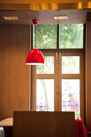 detail of a modern living room with sofa lamp and red cushions Stock Photo - 18401262