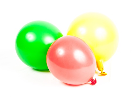 inflated: inflated and deflated balloon over white background