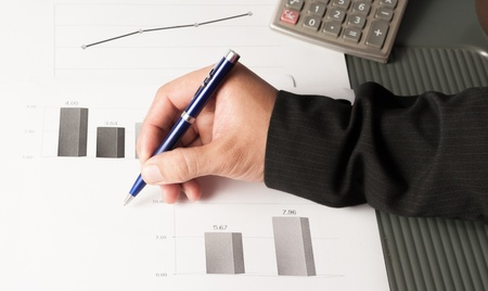 statistically: charts and graphs of sales of securities - workplace successful business man Stock Photo