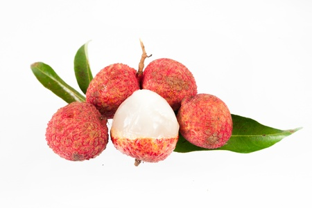 Ripe fruit of the lychee tree (Litchi chinensis) against white background
