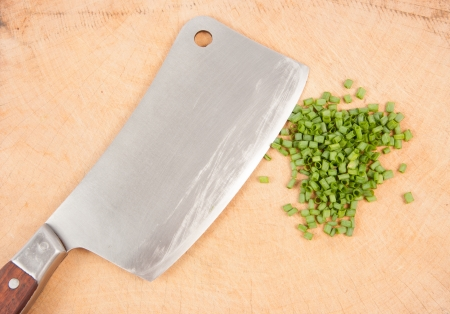 Spring onion and a knife photo