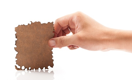 Hand holding piece of burned paper on white background. Stock Photo - 21529529