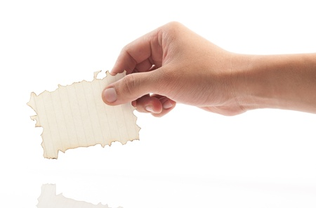 Hand holding piece of burned paper on white background. Stock Photo - 21529559