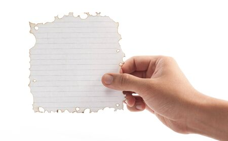 Hand holding piece of burned paper on white background. Stock Photo - 21529560