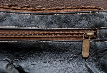 Dark leather texture and zipper background photo