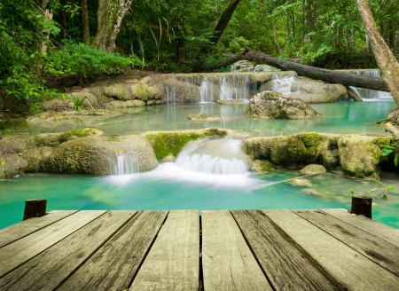 Waterfall in tropical forest at Erawan national park Kanchanaburi province, Thailand Stock Photo